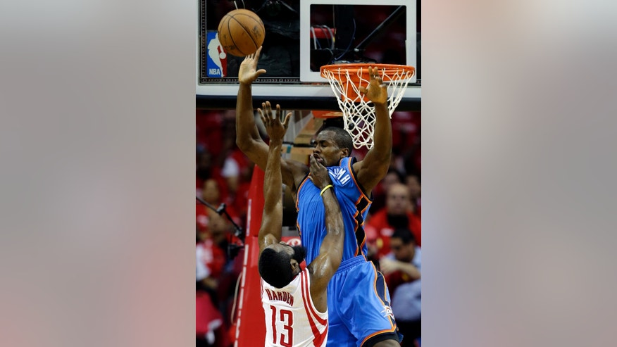 Houston Rockets' James Harden (13) shoots as Oklahoma City Thunder's Serge Ibaka defends during the first quarter of Game 4 in their first-round NBA basketball playoff series Monday, April 29, 2013, in Houston. (AP Photo/David J. Phillip)