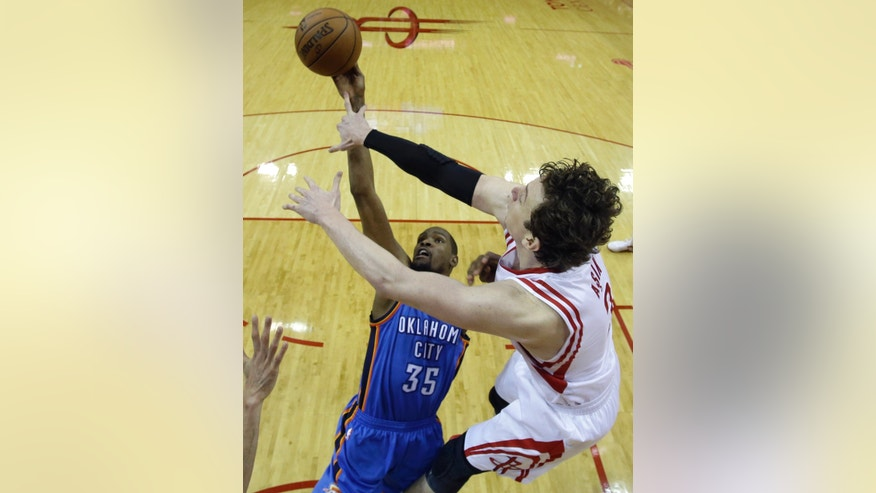 Oklahoma City Thunder's Kevin Durant (35) goes up for a shot as Houston Rockets' Omer Asik (3) defends during the second half of Game 4 in a first-round NBA basketball playoff series Monday, April 29, 2013, in Houston. The Rockets beat the Thunder 105-103. (AP Photo/David J. Phillip)