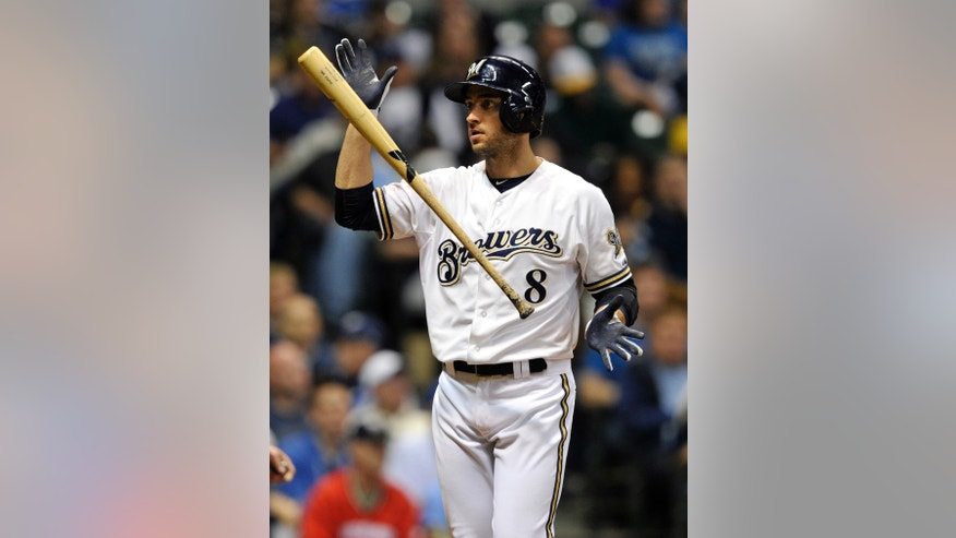 Milwaukee Brewers' Ryan Braun (8) reacts after striking out against the Pittsburgh Pirates during the eighth inning of a baseball game Monday, April 29, 2013, in Milwaukee. (AP Photo/Jim Prisching)