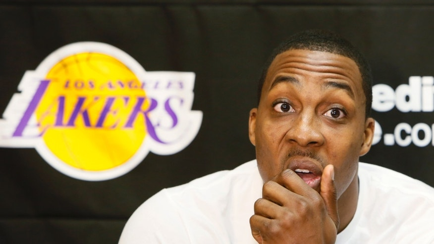 Los Angeles Lakers center Dwight Howard talks to reporters in El Segundo, Calif., Tuesday, April 30, 2013. The Lakes lost their first-round NBA basketball playoff series to the San Antonio Spurs. (AP Photo/Damian Dovarganes)