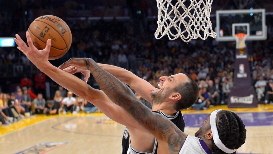 San Antonio Spurs guard Manu Ginobili, left, of Argentina, shoots as Los Angeles Lakers center Jordan Hill defends during the second half in Game 4 of a first-round NBA basketball playoff series, Sunday, April 28, 2013, in Los Angeles. The Spurs won 103-82. (AP Photo/Mark J. Terrill)