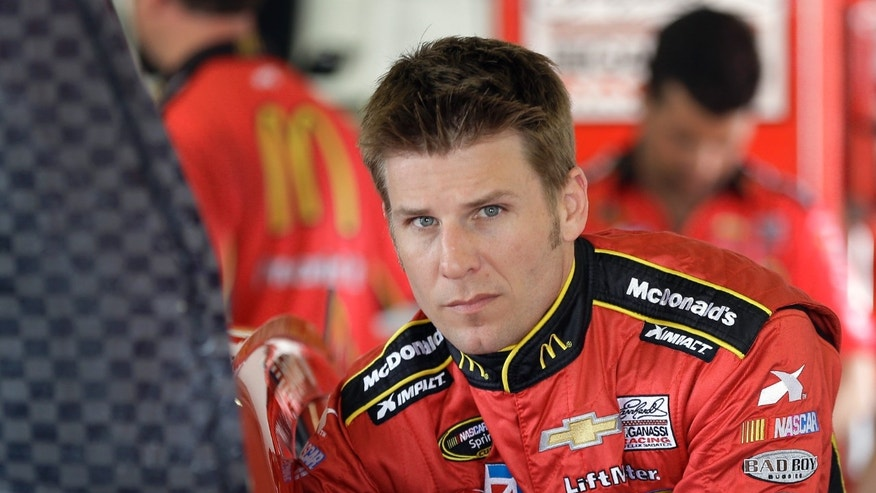 FILE - In this Feb. 22, 2013 file photo, Jamie McMurray climbs into his car during a practice session for the NASCAR Sprint Cup Series Daytona 500 auto race at the Daytona International Speedway in Daytona Beach, Fla. McMurray has no regrets about the way his career has panned out since his 2002 debut. The lessons he's learned about himself and about the people around him have been a fair trade-off for the struggles. (AP Photo/Chris O'Meara, File)