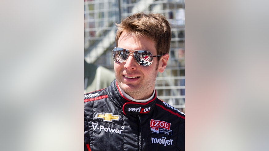 FILE - In this April 21, 2013 file photo, Will Power of Australia smiles at the IndyCar Series Grand Prix of Long Beach auto race in Long Beach, Calif. On the one-year anniversary of his last victory, Power heads back to Brazil for the Sao Paulo 300, a race he has won every time since it was added to the calendar in 2010.  (AP Photo/Ringo H.W. Chiu, File)