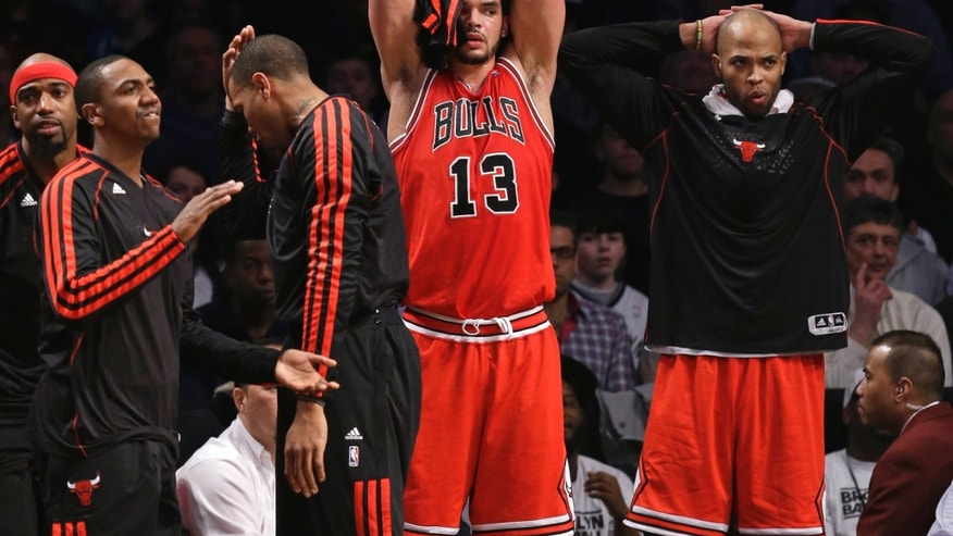 From left, Chicago Bulls' Richard Hamilton, Marquis Teague, Malcolm Thomas, Joakim Noah (13) and Taj Gibson react from the bench in the second half of Game 5 of their first-round NBA basketball playoff series against the Brooklyn Nets, Monday, April 29, 2013, in New York. The Nets won 110-91. (AP Photo/Kathy Willens)