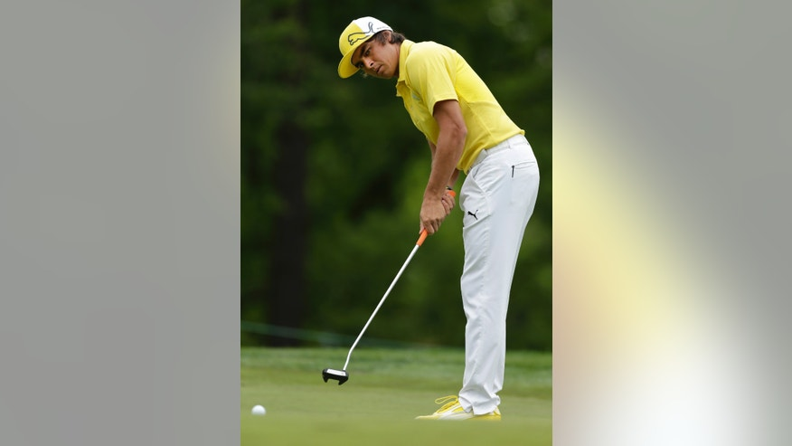 Ricky Fowler watches his putt on the first hole during the pro-am of the Wells Fargo Championship golf tournament at Quail Hollow Club in Charlotte, N.C., Wednesday, May 1, 2013. (AP Photo/Chuck Burton)