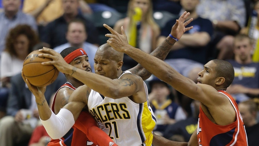 Indiana Pacers' David West (21) is defended by Atlanta Hawks' Josh Smith, left, and Al Horford during the first half of Game 5 in the first round of the NBA basketball playoff series on Wednesday, May 1, 2013, in Indianapolis.  (AP Photo/Darron Cummings)