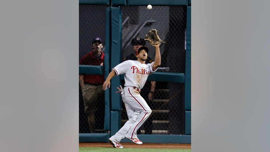 Philadelphia Phillies' Ben Revere catches a fly ball hit by Cleveland Indians' Mike Aviles in the fifth inning of a baseball game on Wednesday, May 1, 2013, in Cleveland. (AP Photo/Tony Dejak)
