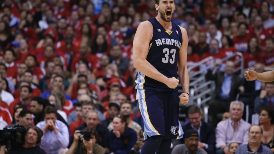 Memphis Grizzlies' Marc Gasol, of Spain, reacts to his basket and a foul call on the Los Angeles Clippers during the first half in Game 5 of a first-round NBA basketball playoff series in Los Angeles, Tuesday, April 30, 2013. (AP Photo/Jae C. Hong)
