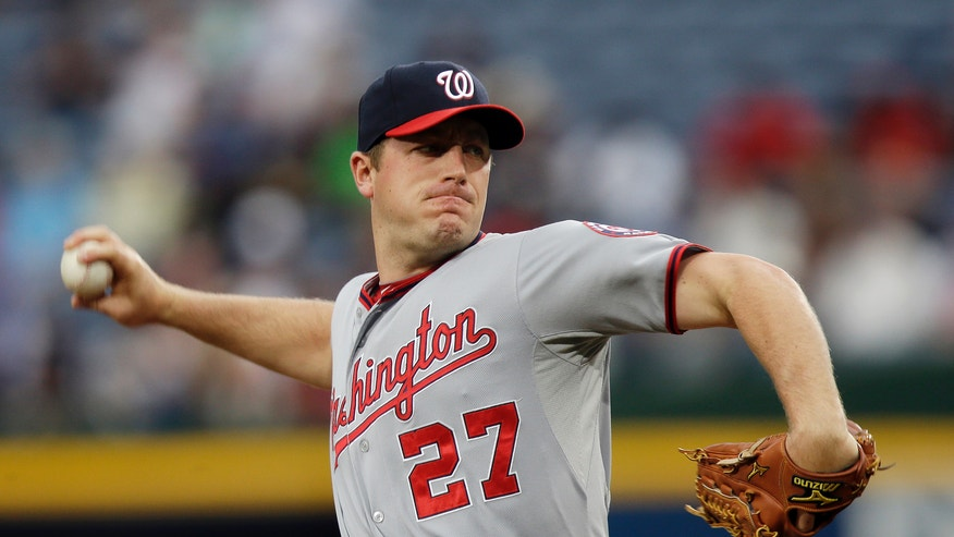 Washington Nationals starting pitcher Jordan Zimmermann throws to an Atlanta Braves batter in the first inning of a baseball game Wednesday, May 1, 2013, in Atlanta. (AP Photo/John Bazemore)