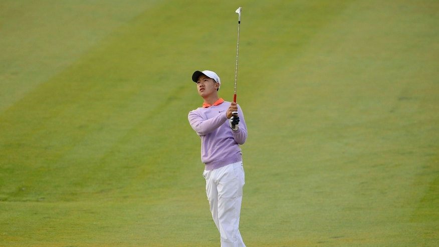 In this photo released by OneAsia, twelve-year-old Chinese amateur golfer Ye Wocheng watches the flight of his shot during the first round of China Open golf tournament at Tianjin Binhai Lake Golf Club in Tianjin, China on Thursday, May 2, 2013. Ye has become the youngest player ever to compete in a European Tour event, shooting a 7-over 79 on Thursday in the first round of the China Open. (AP Photo/OneAsia, Paul Lakatos)
