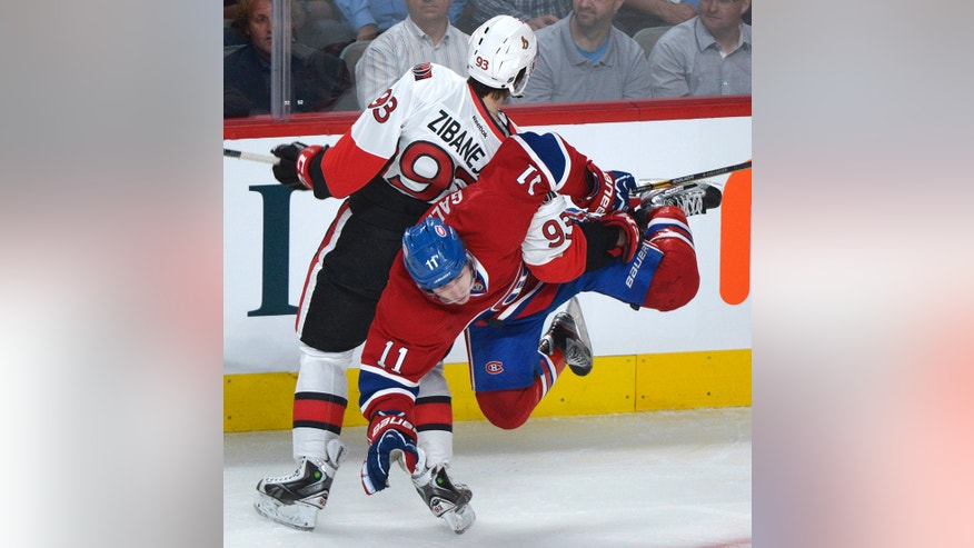 Montreal Canadiens' Brendan Gallagher (11) is flipped by Ottawa Senators' Mika Zibanejad during the first period of Game 1 of an NHL hockey Stanley Cup playoffs first-round series in Montreal on Thursday, May 2, 2013. (AP Photo/The Canadian Press, Graham Hughes)
