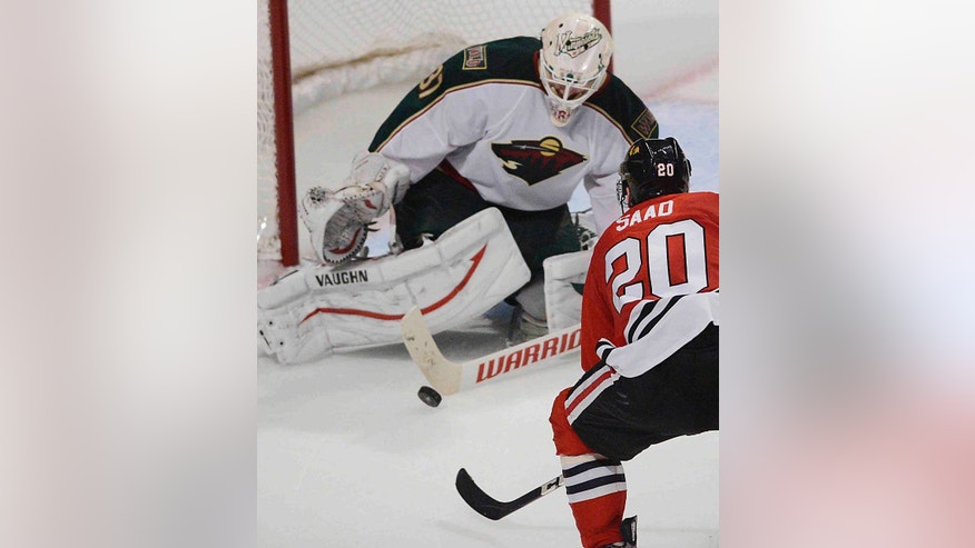 Minnesota Wild goalie Josh Harding defends the net against Chicago Blackhawks left wing Brandon Saad in the third period in Game 1 of an NHL hockey Stanley Cup playoff series Tuesday, April 30, 2013, in Chicago. The Blackhawks defeated the Wild 2-1. (AP Photo/Daily Herald,  John Starks )