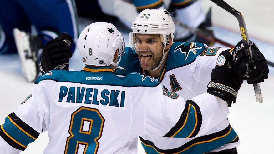 San Jose Sharks' Dan Boyle, right, celebrates his goal against the Vancouver Canucks with teammate Joe Pavelski during the third period in game 1 of an NHL Western Conference quarter-final playoff hockey series in Vancouver, British Columbia Wednesday May 1, 2013. (AP Photo/The Canadian Press, Darryl Dyck)