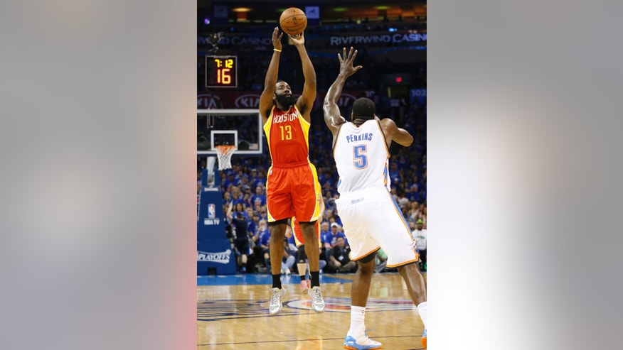 Houston Rockets guard James Harden (13) shoots over Oklahoma City Thunder center Kendrick Perkins (5) in the first quarter of Game 5 of a first-round NBA basketball playoff series in Oklahoma City, Wednesday, May 1, 2013. (AP Photo/Sue Ogrocki)