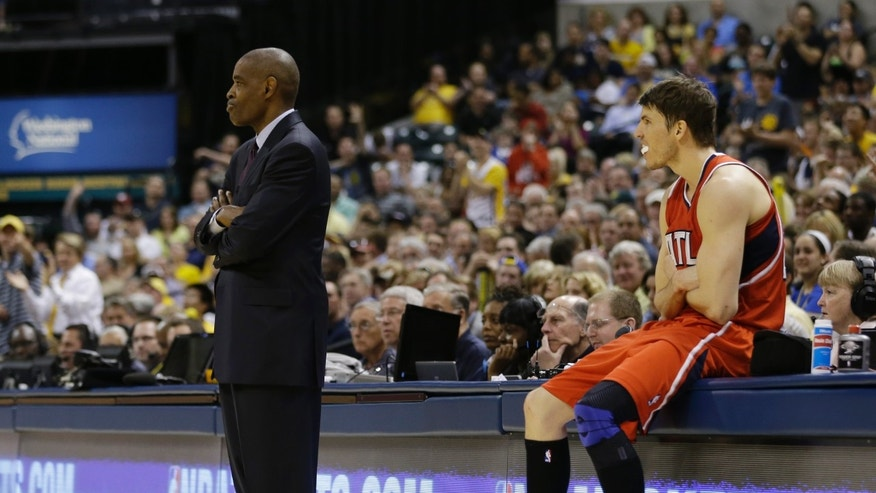 Atlanta Hawks head coach Larry Drew, left, and Kyle Korver react after Korver was called for a foul during the second half of Game 5 in the first round of the NBA basketball playoff series against the Indiana Pacers, Wednesday, May 1, 2013, in Indianapolis. Indiana defeated Atlanta 106-83. (AP Photo/Darron Cummings)