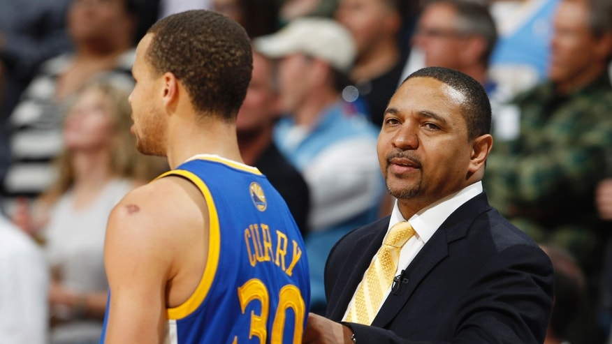 Golden State Warriors head coach Mark Jackson, right, consoles guard Stephen Curry as Curry is pulled late in their 107-100 loss to the Denver Nuggets in Game 5 of their first-round NBA basketball playoff series, Tuesday, April 30, 2013, in Denver. (AP Photo/David Zalubowski)