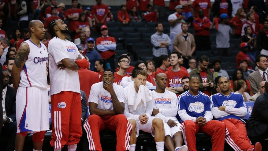 The Los Angeles Clippers bench looks on during the second half in Game 5 of a first-round NBA basketball playoff series against the Memphis Grizzlies in Los Angeles, Tuesday, April 30, 2013. The Grizzlies won 103-93. (AP Photo/Jae C. Hong)