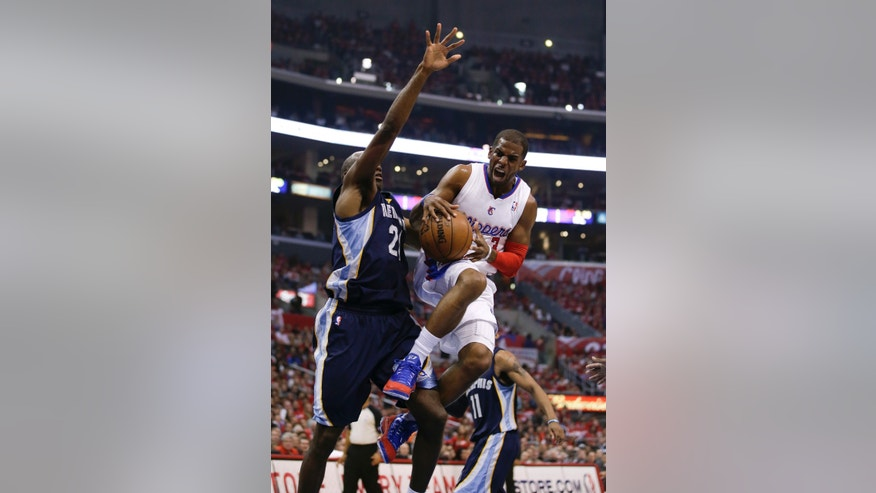 Los Angeles Clippers' Chris Paul, right, is defended by Memphis Grizzlies' Quincy Pondexter during the first half in Game 5 of a first-round NBA basketball playoff series in Los Angeles, Tuesday, April 30, 2013. (AP Photo/Jae C. Hong)