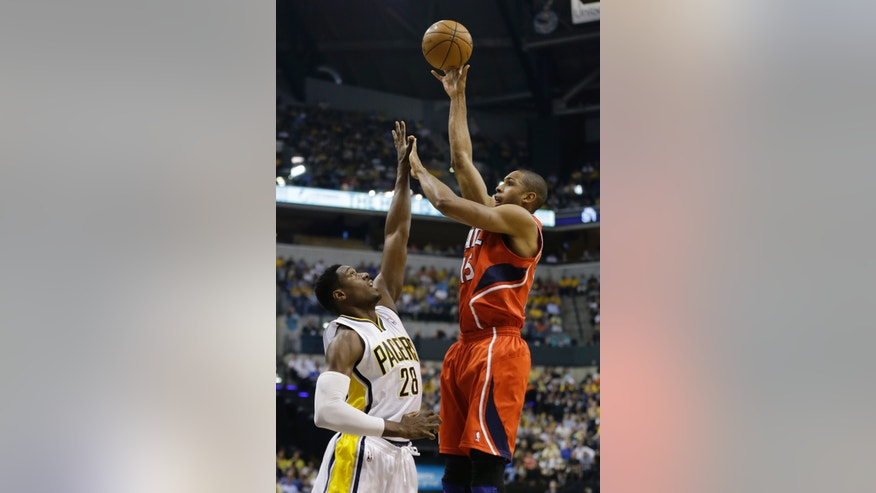 Atlanta Hawks' Al Horford (15) shoots against Indiana Pacers' Ian Mahinmi (28) during the first half of Game 5 in the first round of the NBA basketball playoff series on Wednesday, May 1, 2013, in Indianapolis. (AP Photo/Darron Cummings)