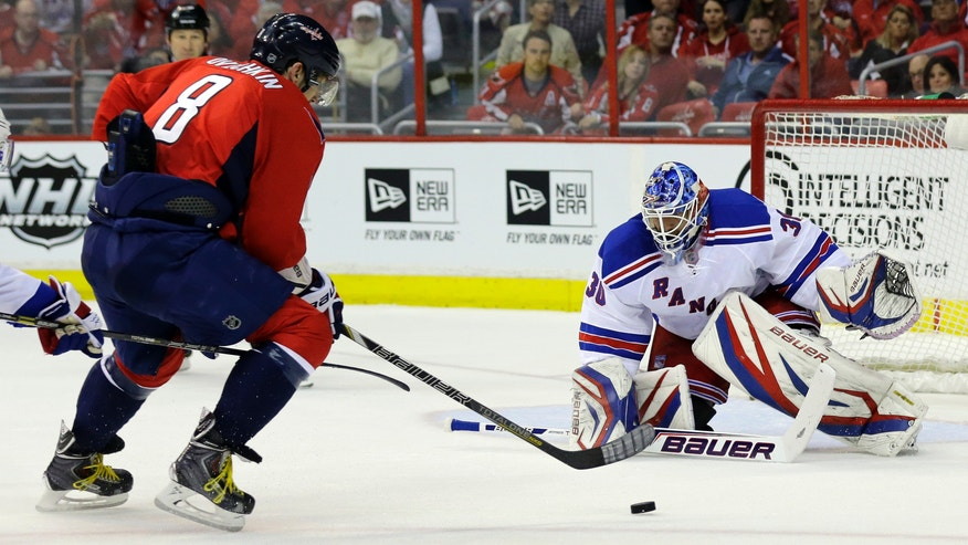 Washington Capitals left wing Alex Ovechkin (8), from Russia, prepares to shoot the puck as New York Rangers goalie Henrik Lundqvist (30), from Sweden, prepares to block in the first period of Game 1 of a Stanley Cup NHL playoff hockey series on Thursday, May 2, 2013, in Washington. (AP Photo/Alex Brandon)