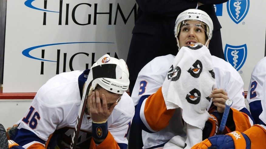 New York Islanders' Marty Reasoner (16) and Travis Hamonic (3) sit on the bench during the third period of Game 1 of an NHL hockey Stanley Cup first-round playoff series against the Pittsburgh Penguins, Wednesday, May 1, 2013, in Pittsburgh. The Penguins won 5-0. (AP Photo/Gene J. Puskar)