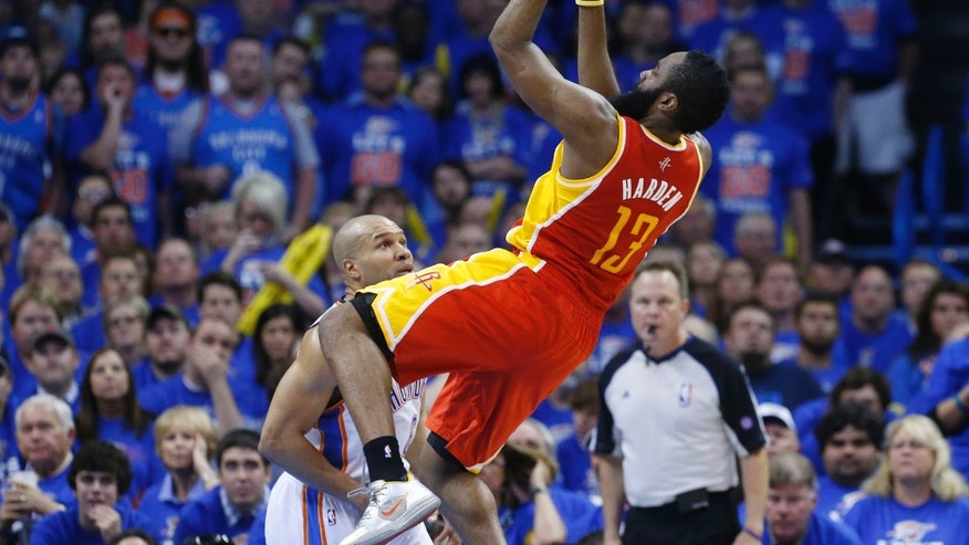 Houston Rockets guard James Harden (13) shoots in front of Oklahoma City Thunder guard Derek Fisher in the fourth quarter of Game 5 of their first-round NBA basketball playoff series in Oklahoma City, Wednesday, May 1, 2013. Houston won 107-100. (AP Photo/Sue Ogrocki)
