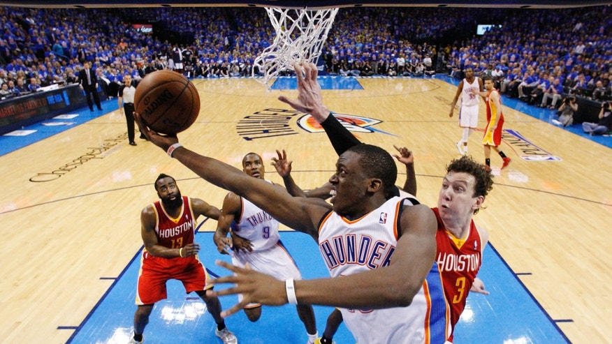 Oklahoma City Thunder guard Reggie Jackson (15) shoots in front of Houston Rockets center Omer Asik (3) in the fourth quarter of Game 5 of their first-round NBA basketball playoff series in Oklahoma City, Wednesday, May 1, 2013. Houston won 107-100. (AP Photo/Sue Ogrocki)