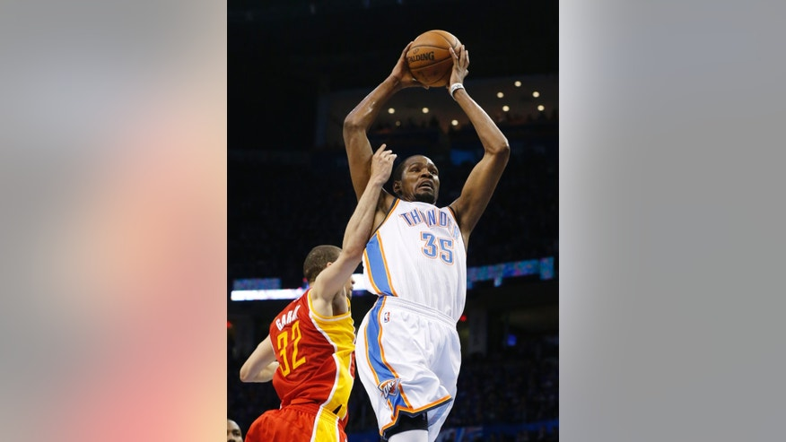 Oklahoma City Thunder forward Kevin Durant (35) is fouled by Houston Rockets forward Francisco Garcia as he shoots in the third quarter of Game 5 of their first-round NBA basketball playoff series in Oklahoma City, Wednesday, May 1, 2013. Houston won 107-100. (AP Photo/Sue Ogrocki)