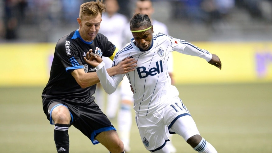 FC Edmonton's Neil Hlavaty (4) fights for possession of the ball with Vancouver Whitecaps' Darren Mattocks (11) during the first half of their second-leg semifinal Amway Canadian Championship soccer match, Wednesday, May 1, 2013, in Vancouver, British Columbia. (AP Photo/The Canadian Press, Justin Tang)