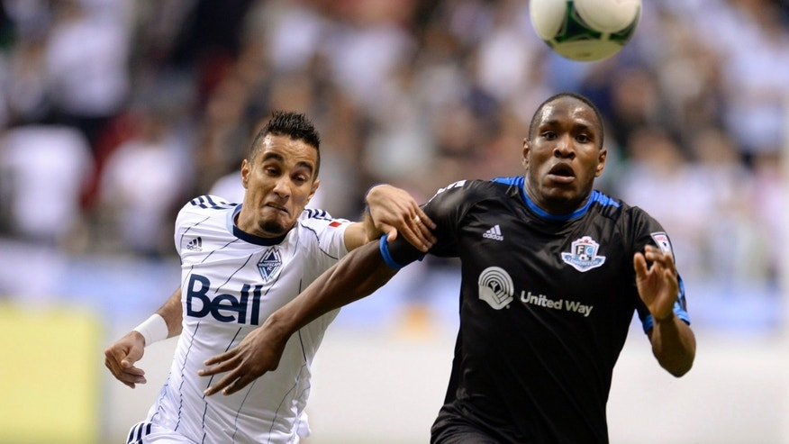 Vancouver Whitecaps' Camilo Sanvezzo (7) challenges FC Edmonton's Edison Edward (3) for possession during the first half of their second-leg semifinal Amway Canadian Championship soccer match, Wednesday, May 1, 2013, in Vancouver, British Columbia. (AP Photo/The Canadian Press, Justin Tang)