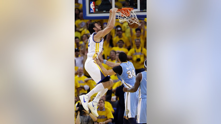 Golden State Warriors' Andrew Bogut dunks over Denver Nuggets' JaVale McGee during the second half of Game 6 in a first-round NBA basketball playoff series in Oakland, Calif., Thursday, May 2, 2013. Golden State won 92-88. (AP Photo/Marcio Jose Sanchez)
