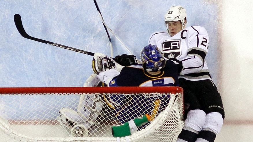 Los Angeles Kings' Dustin Brown, right, collides with St. Louis Blues goalie Brian Elliott during the third period in Game 2 of a first-round NHL hockey Stanley Cup playoff series, Thursday, May 2, 2013, in St. Louis. The Blues won 2-1. (AP Photo/Jeff Roberson)