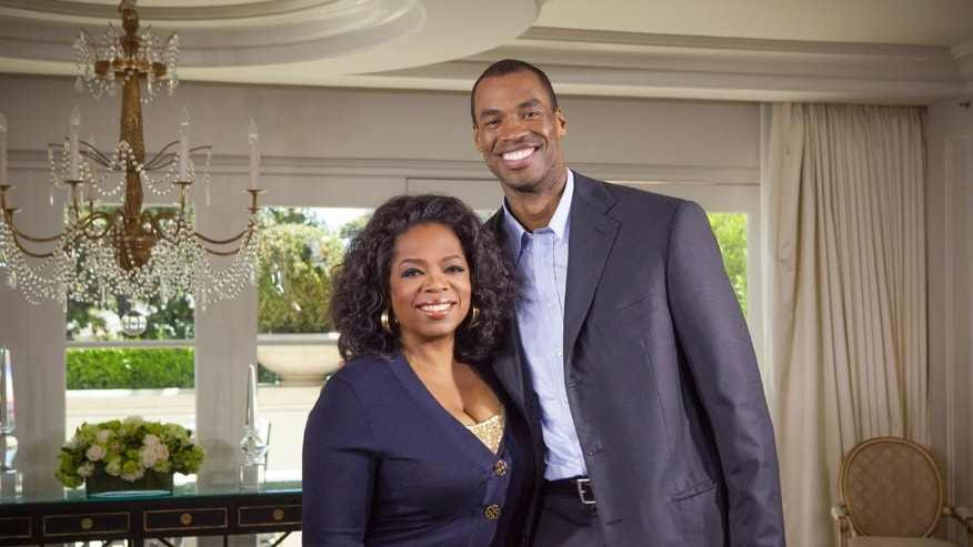 "This May 1, 2013 photo released by OWN shows host Oprah Winfrey posing with NBA  basketball player Jason Collins during an interview for ""Oprah's Next Chapter,"" in Beverly Hills, Calif. Winfrey speaks with Collins, his twin brother Jarron and family for their first interview together on the heels of Collins' public announcement as the first openly gay active pro athlete in a major American sport. The expanded episode of ""Oprah's Next Chapter"" airs this Sunday, May 5 from 7:30 p.m. on OWN: Oprah Winfrey Network. (AP Photo/OWN, Chuck Hodes)"