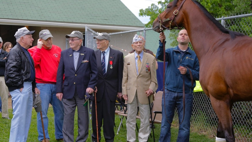 "World War II veterans, who were part of the Normandy Invasion,  view ""their"" horse, Normandy Invasion at the backside of Churchill Downs Friday, May 3, 2013 in Louisville.   From left, Ray Woods, Rick Porter  (owner of Normandy Invasion,)   Ray Woods, Alan Reeves, J. J. Witmeyer, and Chad Brown, trainer of Normandy Invasion.  (AP Photo/The Courier-Journal, Bill Luster) NO SALES; MAGS OUT; NO ARCHIVE; MANDATORY CREDIT"