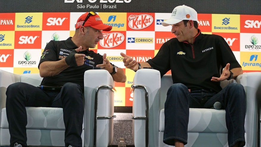 Brazilian IndyCar drivers Tony Kanaan, left, and Helio Castroneves talk during a news conference in Sao Paulo, Brazil, Thursday, May 2, 2013.  Brazil will host the 4th race of the Indy Car season on May 5. (AP Photo/Andre Penner)