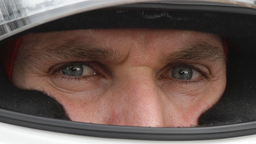 FILE - In this April 28, 2012 file photo, IndyCar driver Will Power, of Australia, looks out from his helmet during a practice session in Sao Paulo, Brazil. On the one-year anniversary of his last victory, Power heads back to Brazil for the Sao Paulo 300, a race he has won every time since it was added to the calendar in 2010.  (AP Photo/Andre Penner, File)