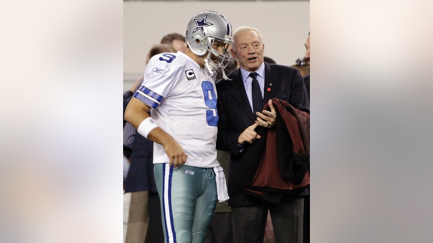 ADVANCE FOR WEEKEND EDITIONS, MAY 4-5 - FILE - In this Dec. 11, 2011 file photo, Dallas Cowboys quarterback Tony Romo (9) and team owner Jerry Jones, right, talk before an NFL football game against the New York Giants, in Arlington, Texas. Jones first alluded to an expanded role for Romo the day the Cowboys owner and general manager signed his quarterback to a $108 million extension with more guaranteed money than Super Bowl winner Joe Flacco. (AP Photo/Tony Gutierrez, File)