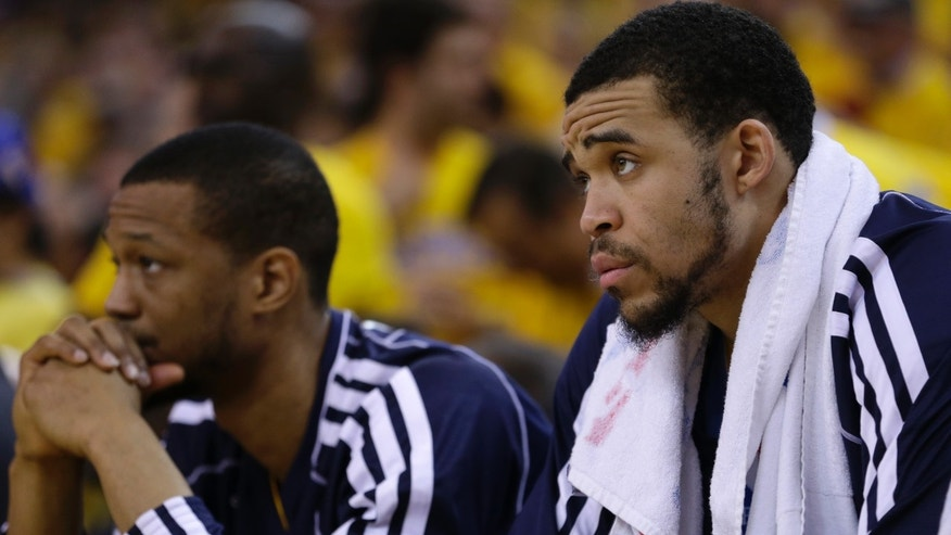Denver Nuggets' Anthony Randolph, left, and JaVale McGee watch from the bench during the second half of Game 6 in a first-round NBA basketball playoff series against the Golden State Warriors on Thursday, May 2, 2013, in Oakland, Calif. (AP Photo/Ben Margot)