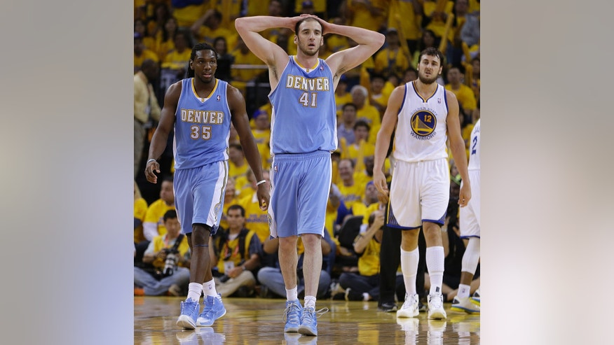 Denver Nuggets center Kosta Koufos (41) and Kenneth Faried (35) walk off the court during the second half of Game 6 in a first-round NBA basketball playoff series against the Golden State Warriors on Thursday, May 2, 2013, in Oakland, Calif. At right is Warriors' Andrew Bogut.  (AP Photo/Ben Margot)
