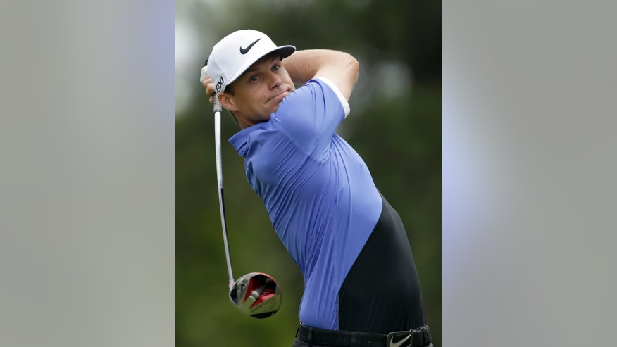 Nick Watney watches his tee shot on the fourth hole during the second round of the Wells Fargo Championship golf tournament at Quail Hollow Club in Charlotte, N.C., Friday, May 3, 2013. (AP Photo/Chuck Burton)