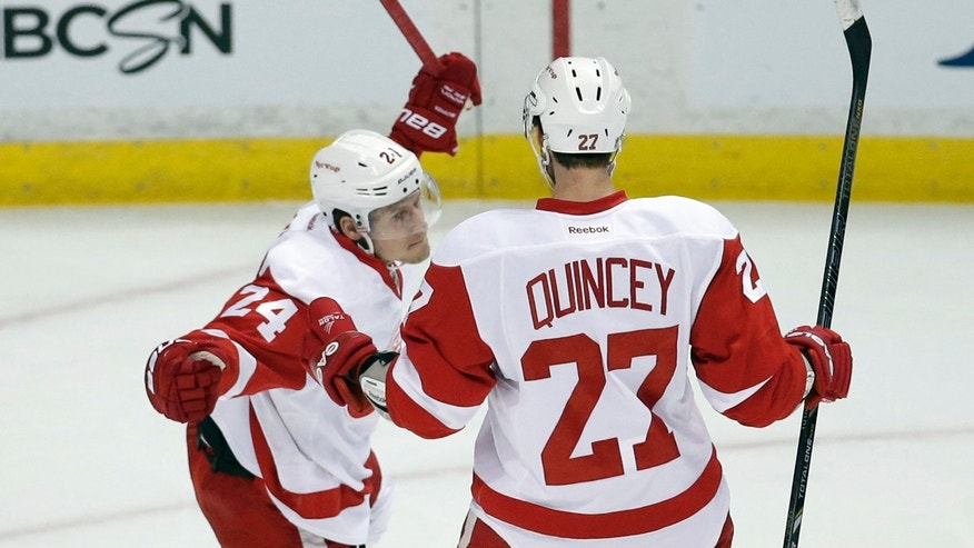 Detroit Red Wings center Damien Brunner, left, celebrates his goal with Kyle Quincey against the Anaheim Ducks during the first period in Game 2 of their first-round NHL hockey Stanley Cup playoff series in Anaheim, Calif., Thursday, May 2, 2013. (AP Photo/Chris Carlson)