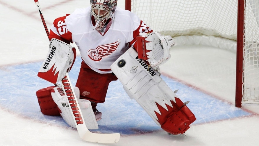 Detroit Red Wings goalie Jimmy Howard blocks a shot against the Anaheim Ducks during the first period in Game 2 of their first-round NHL hockey Stanley Cup playoff series in Anaheim, Calif., Thursday, May 2, 2013. (AP Photo/Chris Carlson)