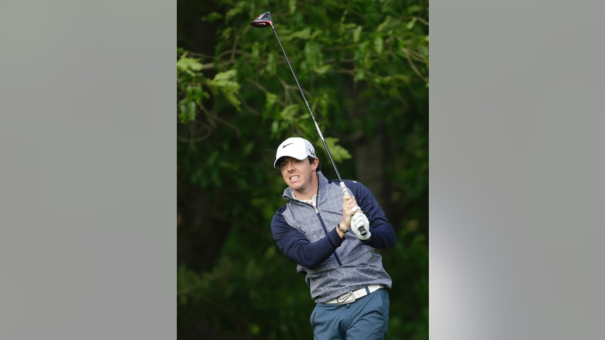 Rory McIlroy, of Northern Ireland, watches his tee shot on the 12th hole during the second round of the Wells Fargo Championship golf tournament at Quail Hollow Club in Charlotte, N.C., Friday, May 3, 2013. (AP Photo/Chuck Burton)