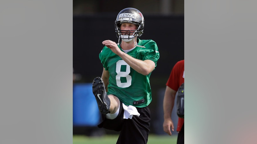 Tampa Bay Buccaneers quarterback Mike Glennon stretches during NFL football rookie minicamp Friday, May 3, 2013, in Tampa, Fla. Glennon, out of North Carolina State,  was the Buccaneers third-round pick in the 2013 draft. (AP Photo/Chris O'Meara)