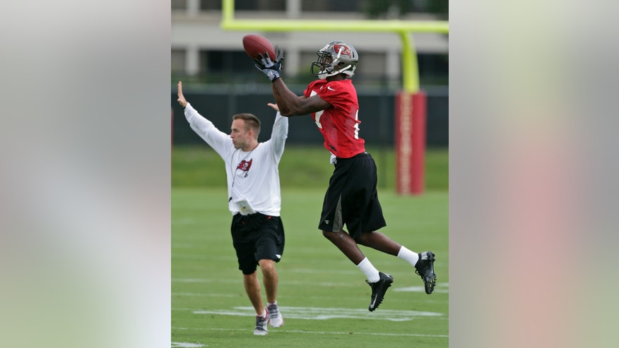 Tampa Bay Buccaneers cornerback Johnthan Banks, right, makes a catch during NFL football rookie minicamp Friday, May 3, 2013, in Tampa, Fla. Banks, out of Mississippi State, was the Buccaneers' second-round pick. (AP Photo/Chris O'Meara)