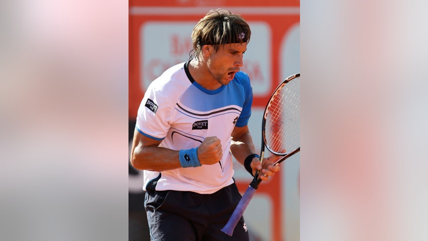 Spain's David Ferrer celebrates winning a point during his Portugal Open quarterfinals tennis match with Roumania's Victor Hanescu, Friday May 3, 2013, in Oeiras, outside Lisbon. Ferrer defeated Hanescu 6-4, 7-6. (AP Photo/Armando Franca)