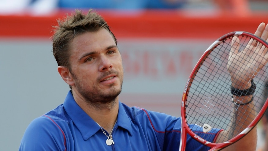 Switzerland's Stanislas Wawrinka reacts after winning his Portugal Open quarterfinals tennis match, Friday May 3, 2013, in Oeiras, outside Lisbon. Wawrinka defeated Portugal's Gastao Elias 6-4, 6-4. (AP Photo/Armando Franca)