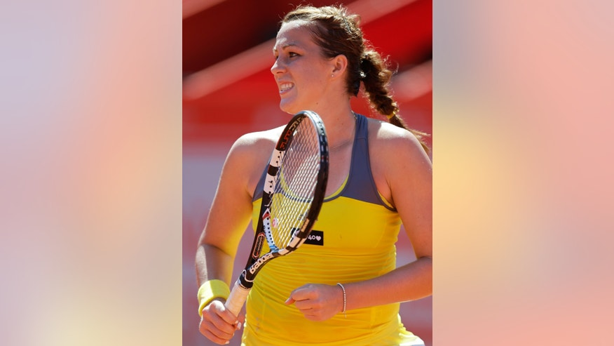 Russia's Anastasia Pavlyuchenkova celebrates winning a point during her Portugal Open semifinal tennis match against Switzerland's Romina Oprandi Friday, May 3 2013, in Oeiras, outside Lisbon. Pavlyuchenkova defeated Oprandi 0-6, 6-3, 6-1. (AP Photo/Armando Franca)