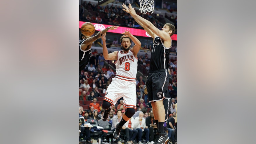 Chicago Bulls guard Marco Belinelli (8), of Italy, cannot control the ball against Brooklyn Nets guard Joe Johnson, left, and center Brook Lopez during the second half in Game 6 of their first-round NBA basketball playoff series in Chicago, Thursday, May 2, 2013. The Nets won 95-92. (AP Photo/Nam Y. Huh)