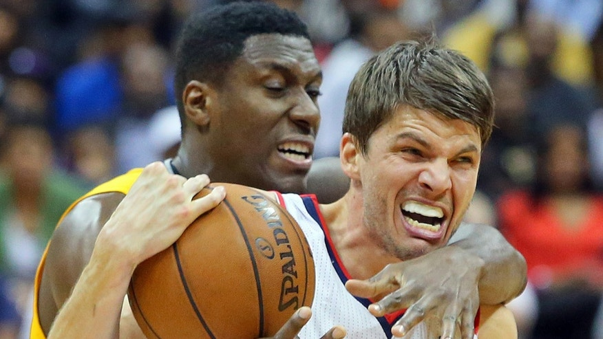Atlanta Hawks' Kyle Korver and Indiana Pacers' Ian Mahinmi scramble for the ball during the second half of Game 6 of an NBA basketball first-round playoff series Friday, May 3, 2013, in Atlanta. The Pacers won 81-73 and took the series. (AP Photo/Atlanta Journal Constitution, Curtis Compton) GWINNETT OUT  MARIETTA OUT